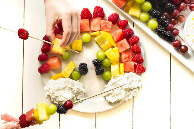 Kids love assembling these DIY Rainbow Fruit Kabobs!