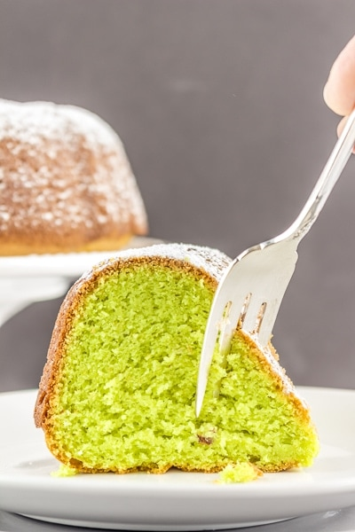 A show-stopping Pistachio Cake that is secretly easy to make with your favorite cake mix and a few other simple ingredients. #glutenfree #glutenfreecake #pistachiocake #LifeAfterWheat