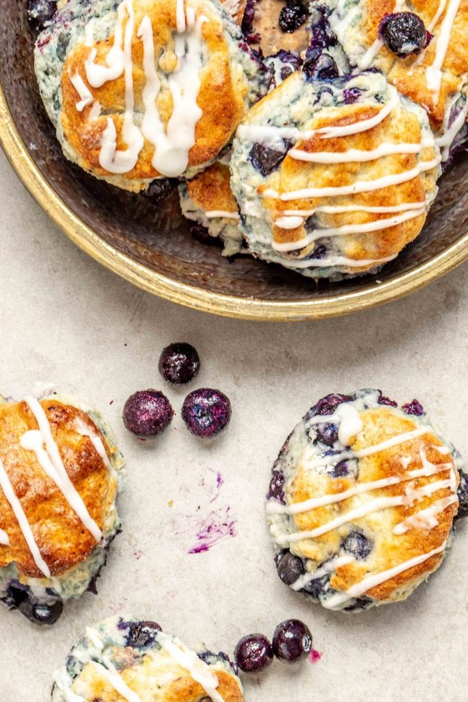 Perfect for breakfast or brunch, these beautiful gluten free blueberry biscuits are perfectly light and fluffy, slightly sweet, and studded with blueberries.