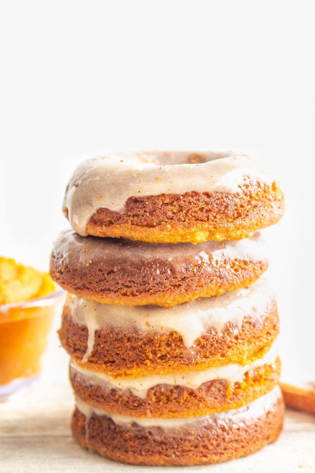 All you'll need to make these Pumpkin Spice Donuts are a few simple ingredients, a bowl, and a spoon! They're naturally grain free, paleo, gluten free, and dairy free too. #glutenfreedonuts #paleodonuts #pumpkindonuts #bakeddonuts