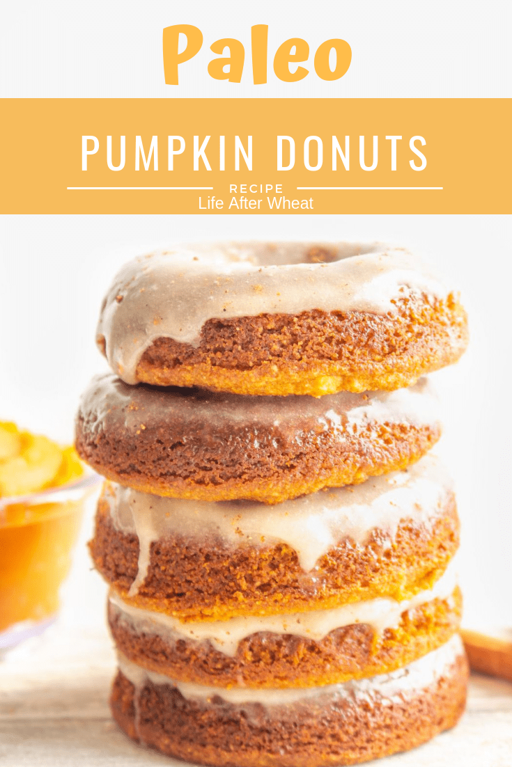 These gluten free donuts are bursting with pumpkin spice flavor & are a kid favorite! Easy to make, naturally grain free, paleo, gluten free, & dairy free. #LifeAfterWheat #glutenfreedonuts #bakeddonuts #paleodonuts