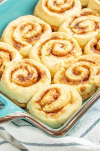 The BEST Gluten Free Cinnamon Rolls you'll ever eat! Soft and fluffy thanks to a *secret* ingredient. #glutenfreecinnamonrolls #glutenfree #glutenfreebaking #glutenfreebreakfast #LifeAfterWheat