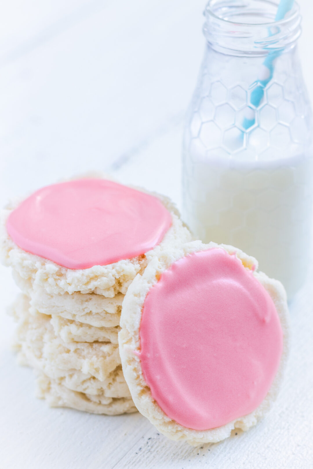 Swig cookies: A stack of sugar cookies with pink frosting and a glass of milk