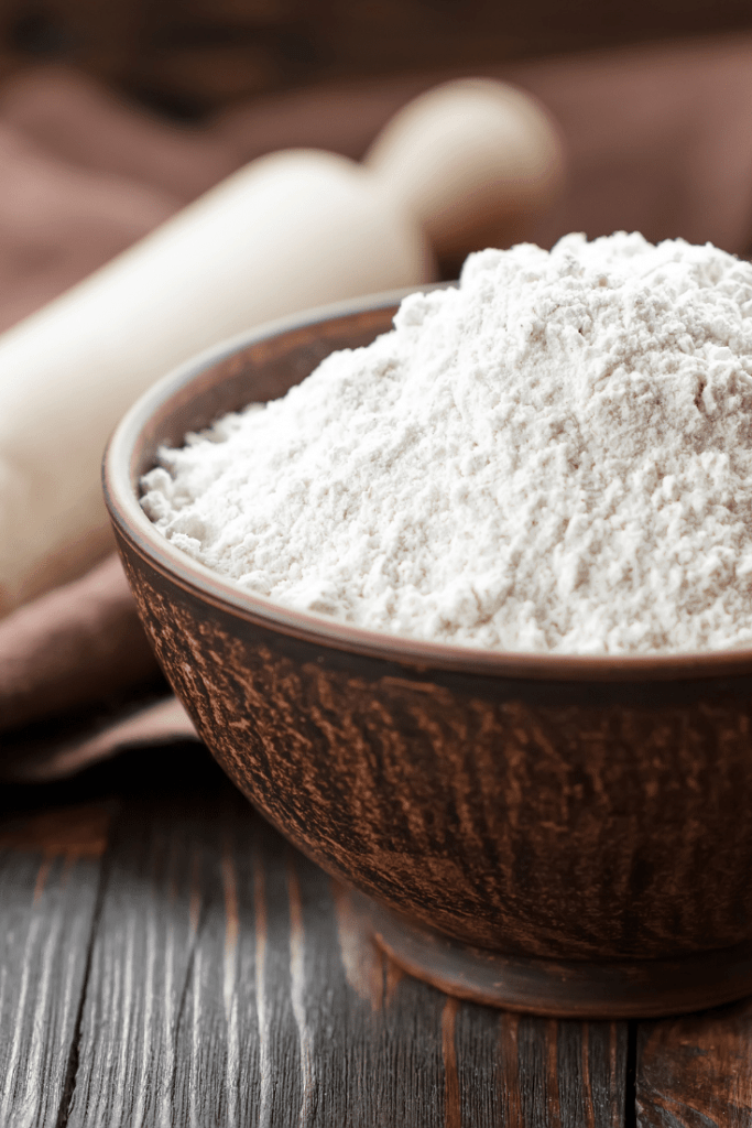 bowl of flour with rolling pin in background
